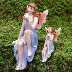 Fairy XL zittend blauwe jurk